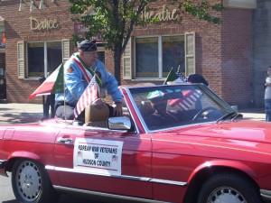 Korean War Vet Lucky Pasqua and son Ralph ride in the parade