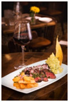 Enjoy a glass a wine and dinner at La Isla Hoboken